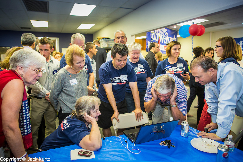 28 AUGUST 2012 - PHOENIX, AZ:  Rep. David Schweikert's supporters watch Ben Quayle's concession speech Tuesday night. Schweikert faced Congressman Ben Quayle in what was the hardest Republican primary election in Arizona in 2012. Both were incumbent Republican freshmen elected to Congress from neighboring districts in 2010. They ended up in the same district at the end of the redistricting process and faced off against each other in the primary to represent Arizona's 6th Congressional District, which is made up of Scottsdale, Paradise Valley and parts of Phoenix. The district is solidly Republican and the winner of the primary is widely expected to win November's general election. Both are conservative Republicans with Tea Party backing.   PHOTO BY JACK KURTZ