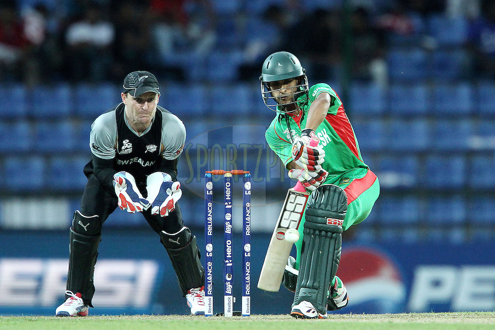 Nasir Hossain bats whilst Brendon McCullum keeps wicket during the ICC World Twenty20 Pool match between New Zealand and Bangladesh held at the  Pallekele Stadium in Kandy, Sri Lanka on the 21st September 2012..Photo by Ron Gaunt/SPORTZPICS/PHOTOSPORT