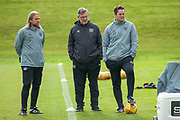 Heart of Midlothian manager Craig Levein (dark jacket), Austin Macphee (left) and coach Jon Daly during training at the Oriam Sports Performance Centre, Edinburgh on 13 September 2018, ahead of the away match against Motherwell.
