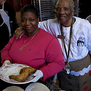 Sister Jean with one of  Kitchen Volunteers holding plate of food for the homeless. <br />