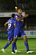 Lyle Taylor AFC Wimbledon sets himself up and scores during the Johnstone's Paint Trophy match between AFC Wimbledon and Plymouth Argyle at the Cherry Red Records Stadium, Kingston, England on 1 September 2015. Photo by Stuart Butcher.