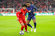 Tottenham Hotspur midfielder Ryan Sessegnon (19) held off by Bayern Munich midfielder Serge Gnabry (22) during the Champions League match between Bayern Munich and Tottenham Hotspur at Allianz Arena, Munich, Germany on 11 December 2019.