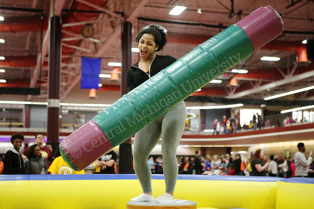 On Saturday, March 28, 2015, hundreds of students entered the SAC for a long night of fun. The event, Up All Night, lasted from 11 p.m. to 3 a.m., and students enjoyed complementary gourmet hotdogs from Dog Central, a blow-up obstacle course race, laser tag, dodgeball, caricature artists, dancing and more.<br /> Photo Intern: Katy Kildee