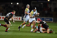 Josh Matavesi  of the Ospreys &copy; is tackled .Guinness Pro12 rugby union, Newport Gwent Dragons v Ospreys at Rodney Parade in Newport, South Wales on Friday 12th Sept 2014<br /> pic by Andrew Orchard, Andrew Orchard sports photography.
