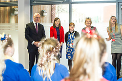 Pictured: John Swinney was welcomed to the school by Head teacher Louise Cook and colleagues and a small choir of pupils<br /> Today Deputy First Minister John Swinney visited Niddrie Mill Primary School to announce the publication of Scottish school statistics such as teacher numbers, ratios and class sizes. <br /> <br /> <br /> Ger Harley | EEm 12 December 2017