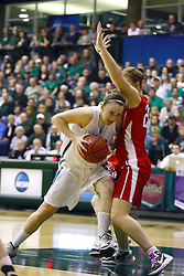 18 March 2011: Olivia Lett drives through the paint with Kristin Anda protecting the basket during an NCAA Womens basketball game between the Washington University Bears and the Illinois Wesleyan Titans at Shirk Center in Bloomington Illinois.