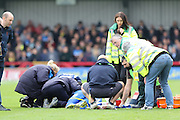 Andy Barcham of AFC Wimbledon sustains and injury and is stretchered off giving 10 minutes injury time during the Sky Bet League 2 match between AFC Wimbledon and Morecambe at the Cherry Red Records Stadium, Kingston, England on 17 October 2015. Photo by Stuart Butcher.