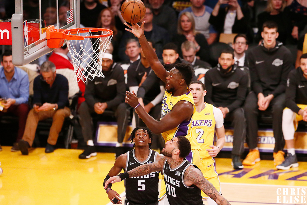 09 January 2018: Los Angeles Lakers forward Julius Randle (30) goes for the layup past Sacramento Kings center Willie Cauley-Stein (00) and Sacramento Kings guard De'Aaron Fox (5) during the LA Lakers 99-86 victory over the Sacramento Kings, at the Staples Center, Los Angeles, California, USA.