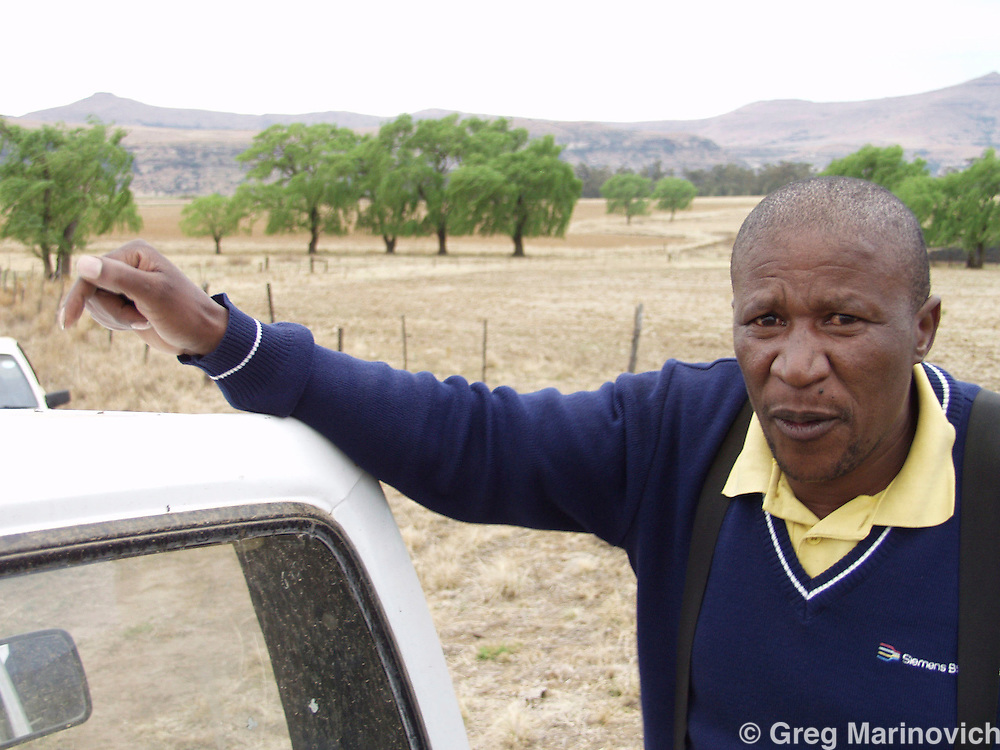 An independent black farmer in the Free State disrict of South Africa on his lands. 2003. Photo Greg Marinovich