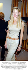 MISS JULIE HAYEK a former Miss USA at a party in London on 10th September 2002.PDD 278