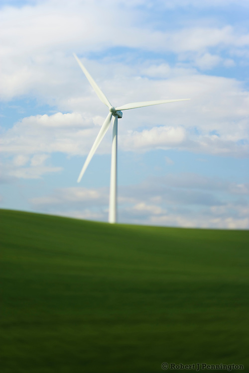 Wind turbines amidst green farming fields in Eastern Washington.