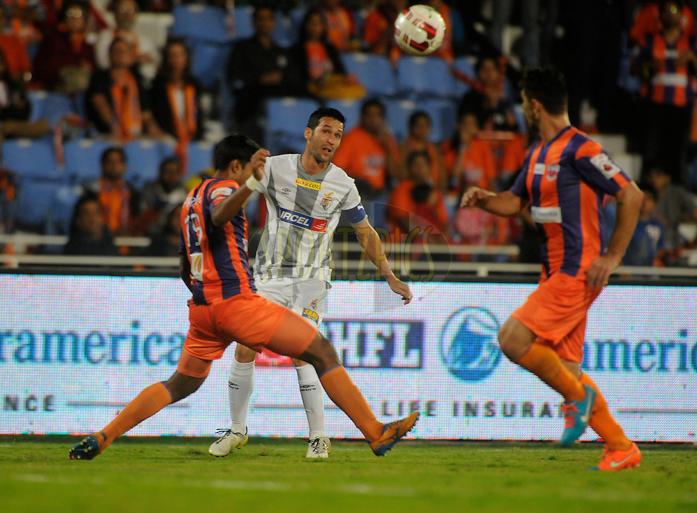 Luis Javier Garcia Sanz of Atletico de Kolkata and Pritam Kotal of FC Pune City during match 44 of the Hero Indian Super League between FC Pune City and Atletico de Kolkata FC held at the Shree Shiv Chhatrapati Sports Complex Stadium, Pune, India on the 29th November 2014.<br /> <br /> Photo by:  Pal Pillai/ ISL/ SPORTZPICS