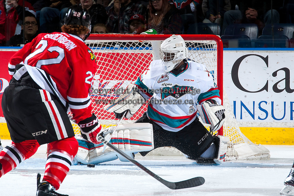 KELOWNA, CANADA - JANUARY 29: Michael Herringer #30 of Kelowna Rockets makes a save against the Portland Winterhawks on January 29, 2016 at Prospera Place in Kelowna, British Columbia, Canada.  (Photo by Marissa Baecker/Shoot the Breeze)  *** Local Caption *** Michael Herringer;