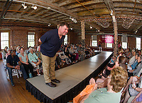 Sporting casual Eddie Bauer attire Fire Chief Ken Erickson takes a bow to an appreciative audience during the Belknap Mill Fashion and Flair Show on Sunday afternoon.  (Karen Bobotas/for the Laconia Daily Sun)