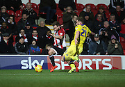 Leeds United defender Charlie Taylor tackling Brentford midfielder Alan Judge during the Sky Bet Championship match between Brentford and Leeds United at Griffin Park, London, England on 26 January 2016. Photo by Matthew Redman.