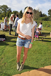 SIENNA MILLER at a cricket match to in aid of CARE - Corfu Animal Rescue Establishment held at Hawkley Cricket Club, Hawkley, Hampshire on 8th September 2012.