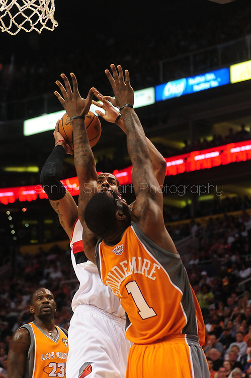Mar. 21 2010; Phoenix, AZ, USA; Portland Trailblazers forward LaMarcus Aldridge (12) puts up a shot against Phoenix Suns forward Amare Stoudemire (1) in the first half at the US Airways Center.   Mandatory Credit: Jennifer Stewart-US PRESSWIRE.