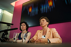 © London News Pictures. 22/07/2014. London, UK. MARINA LITVINENKO (right) speaking at a press conference in London following the British Governments announcement that a public inquiry will be held in to , the death of her husband, former Russian spy, Alexander Litvinenko. The ex-KGB officer was poisoned by a cup of tea laced with the deadly radioactive element polonium 210 during a meeting at a London hotel in 2006. Photo credit : Ben Cawthra/LNP