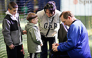 Chester, New York - Former New York Mets baseball all-star player Howard Johnson signs an autograph at the first anniversary open house celebration at The Rock Sports Park on Nov. 12, 2011.