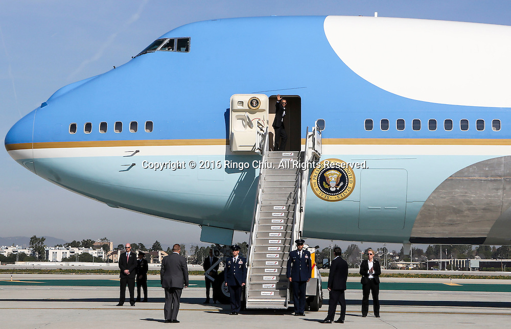 President Barack Obama, waves as he boards Air Force One at Los Angeles International Airport in Los Angeles, Friday, Feb 12, 2016, en route to Palm Springs in advance of a summit of Asian leaders on Monday and Tuesday, which the president will host at Sunnylands resort in Rancho Mirage. Obama will be joined by Secretary of State John Kerry at Sunnylands for the gathering of leaders from the Association of Southeast Asian Nations. The summit is aimed at strengthening the new U.S.-ASEAN strategic partnership, forged last November during a presidential trip to Malaysia. (Photo by Ringo Chiu/PHOTOFORMULA.com)<br /> <br /> Usage Notes: This content is intended for editorial use only. For other uses, additional clearances may be required.