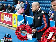 Brentford Head Coach Lee Carsley carries a wreath of poppies to the centre circle prior to the Sky Bet Championship match between Blackburn Rovers and Brentford at Ewood Park, Blackburn<br /> Picture by Mark D Fuller/Focus Images Ltd +44 7774 216216<br /> 07/11/2015