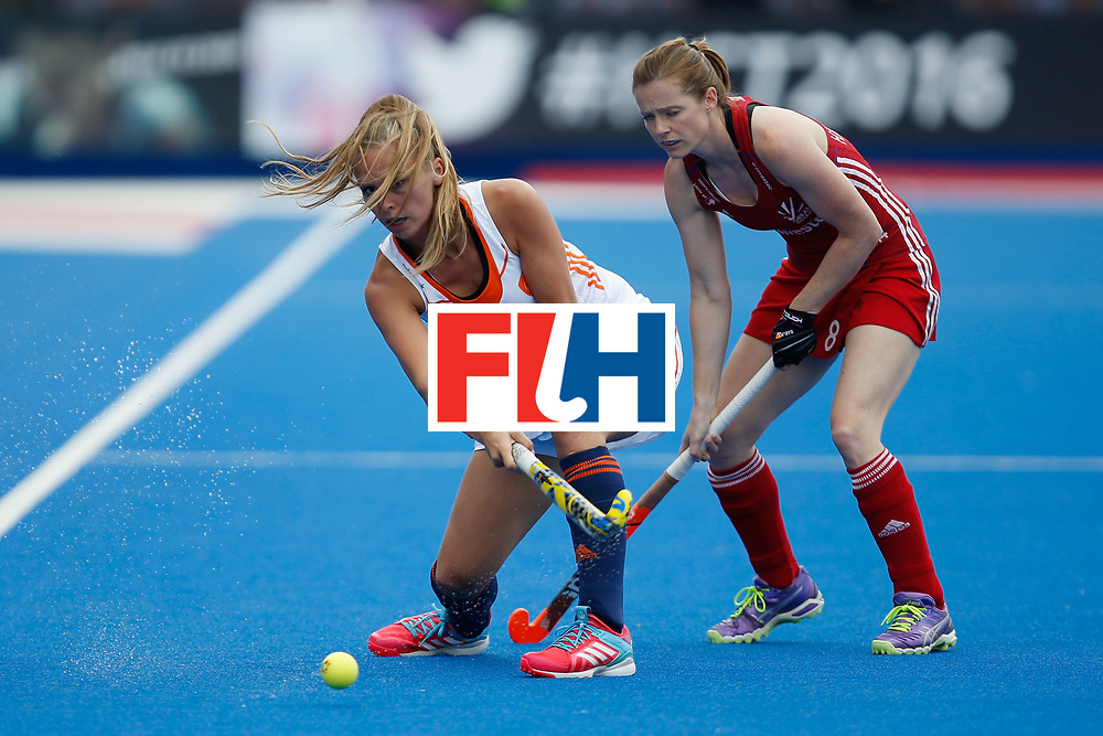 LONDON, ENGLAND - JUNE 19:  Jacky Schoenaker of the Netherlands of the plays a pass in front of Helen Richardson-Walsh of Great Britain during the FIH Women's Hockey Champions Trophy 2016 match between the Netherlands and Great Britain at Queen Elizabeth Olympic Park on June 19, 2016 in London, England.  (Photo by Joel Ford/Getty Images)