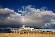 A storm has deposited fresh snow on Pueblo Peak. Taos, New Mexico.