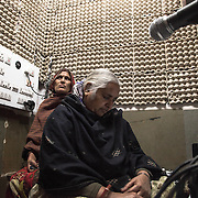 Two women in the Barefoot College Community Radio Station; managed by women of rajasthani villages, it started in 2008 and covers daily for 6 hours a radius of 30km including 30 villages, 21 primary schools, 16 middle schools, and 9 secondary schools. 01/2013