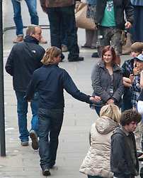 """Day two of filming.  Brad Pitt says hello to crew members and extras as he leaves the set of the movie """"World War Z"""" being shot in the city centre of Glasgow. The film, which is set in Philadelphia, is being shot in various parts of Glasgow, transforming it to shoot the post apocalyptic zombie film.."""