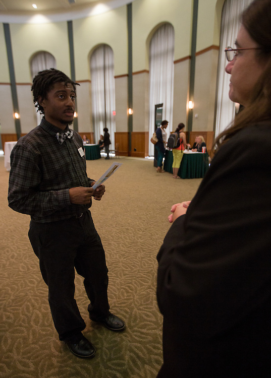 Chris Williams, left, asks Debra Benton, right, for more detailed information about The Ohio Guarantee during the event at Walter Hall rotunda on Wednesday afternoon. Photo by Katelyn Vancouver
