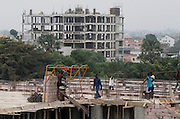 Construction of apartments and office blocks around the Place De La Gare, La Ville, Kinshasa, DRC...© Zute Lightfoot.www.lightfootphoto.com