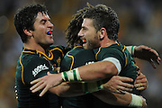 BRISBANE, AUSTRALIA - SEPTEMBER 07:  Willie Le Roux of the Springboks (R) celebrates a try with team mates during The Rugby Championship match between the Australian Wallabies and the South African Springboks at Suncorp Stadium on September 7, 2013 in Brisbane, Australia.  (Photo by Matt Roberts/Getty Images)