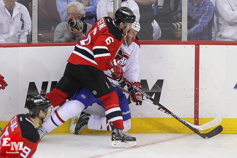 Apr 23, 2013; Newark, NJ, USA; New Jersey Devils defenseman Andy Greene (6) hits Montreal Canadiens right wing Brandon Prust (8) during the third period at the Prudential Center. The Devils defeated the Canadiens 3-2.