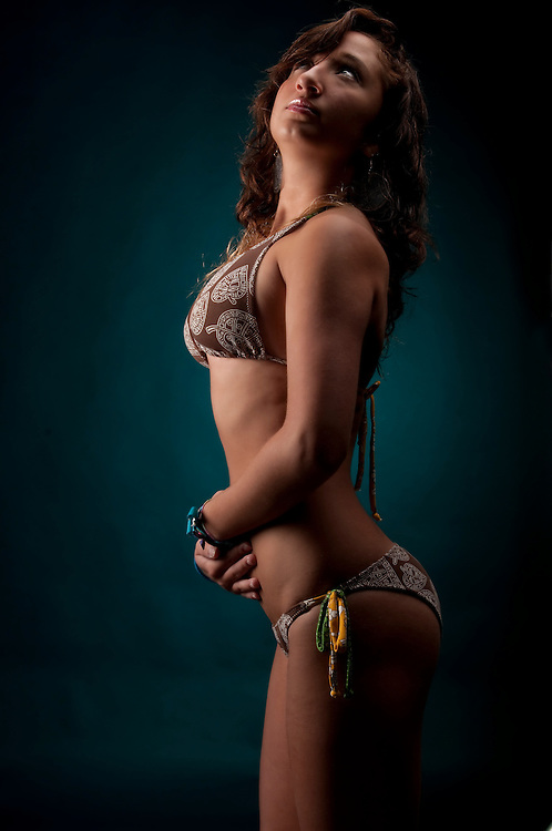 Young hispanic girl posing in bikini very sexy.