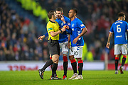 Kyle Lafferty (#11) of Rangers FC tries to stop referee Steven McLean from showing Alfredo Morelos (#20) of Rangers FC a red card during the Ladbrokes Scottish Premiership match between Rangers and Aberdeen at Ibrox, Glasgow, Scotland on 5 December 2018.