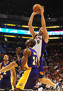 Oct. 29 2010; Phoenix, AZ, USA; Phoenix Suns guard-forward Hedo Turkoglu (19) puts up a basket against Los Angeles Lakers shooting guard Kobe Bryant (24) during the first quarter  at the US Airways Center. Mandatory Credit: Jennifer Stewart-US PRESSWIRE.