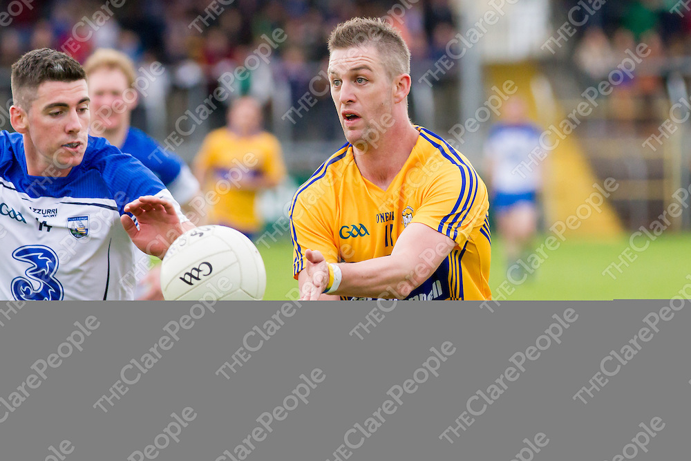 Clare's Enda Coughlan being closed down by Waterford's Paul Whyte