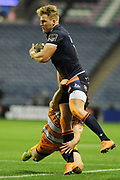 Duhan van der Merwe under pressure during the Guinness Pro 14 2018_19 match between Edinburgh Rugby and Toyota Cheetahs at BT Murrayfield Stadium, Edinburgh, Scotland on 5 October 2018.