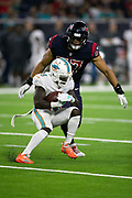 Miami Dolphins wide receiver Jakeem Grant (19) is chased by Houston Texans linebacker Brennan Scarlett (57) after catching a pass during the NFL week 8 regular season football game against the Houston Texans on Thursday, Oct. 25, 2018 in Houston. The Texans won the game 42-23. (©Paul Anthony Spinelli)