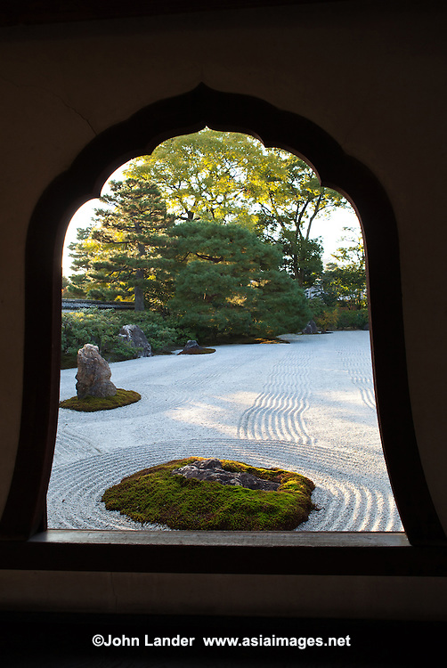 "Daioen Garden Window- To the south of the hojo at Kenninji Temple there is a dry or karesansui garden named ""Daioen"" which means grand garden. It is said that the pattern of white gravel symbolizes a field of clouds.  This effect is helped by the waves and ripples in the gravel which give this effect."
