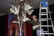 Mark Brueninghaus of The Flower Shop works on decorations for the PNC Bank table during setup of the Aids Resource Center's RED: Reach, Empower, Dream dinner at the Roundhouse of the Montgomery County Fairgrounds in Dayton, Saturday, April 28, 2012.