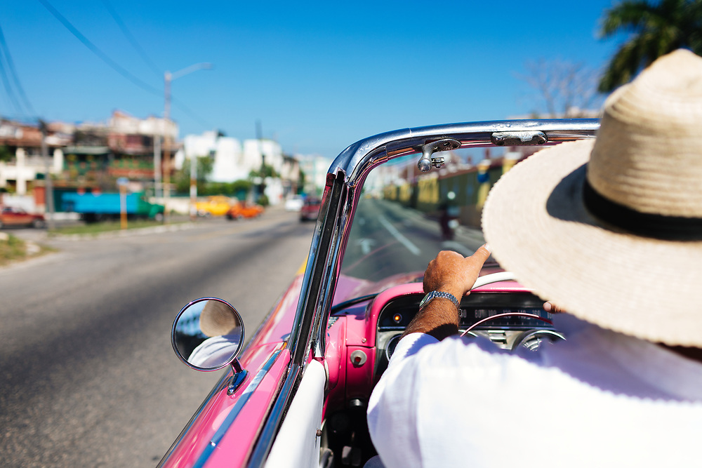 Man drives on a convertible tour of Old Havana in Havana, Cuba