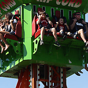 Children show their fear during a ride on the 'Rip Cord' during the May Fair at Saint Mark's Church, New Canaan, Connecticut, USA. 12th May 2012. Photo Tim Clayton