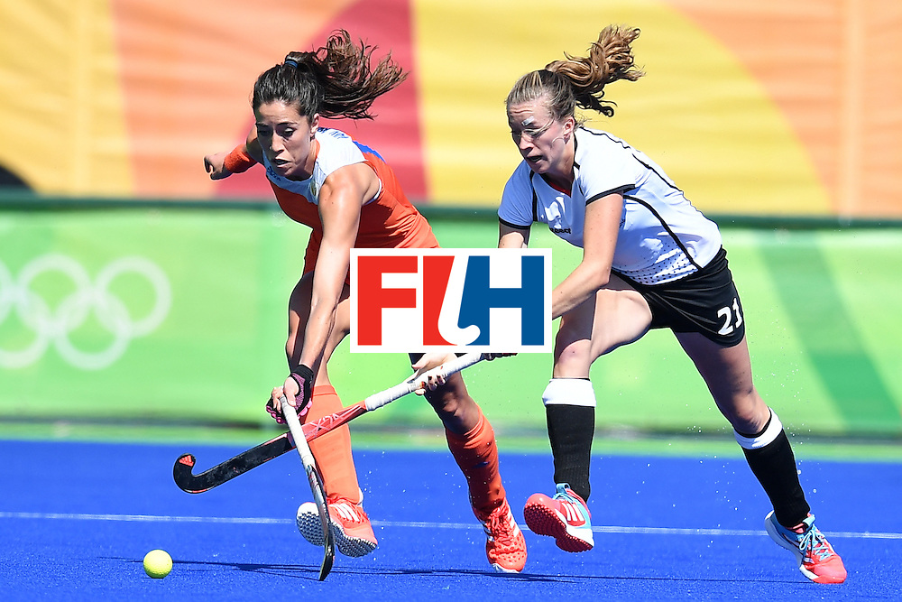 Netherlands' Naomi As van (L) and Germany's Franzisca Hauke vie during the women's field hockey Netherlands vs Germany match of the Rio 2016 Olympics Games at the Olympic Hockey Centre in Rio de Janeiro on August, 13 2016. / AFP / MANAN VATSYAYANA        (Photo credit should read MANAN VATSYAYANA/AFP/Getty Images)