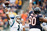 CHICAGO, IL - OCTOBER 22:  Cam Newton #1 of the Carolina Panthers throws a pass over the out stretched arm of Jonathan Bullard #90 of the Chicago Bears at Soldier Field on October 22, 2017 in Chicago, Illinois.  The Bears defeated the Panthers 17-3.  (Photo by Wesley Hitt/Getty Images) *** Local Caption *** Cam Newton; Jonathan Bullard