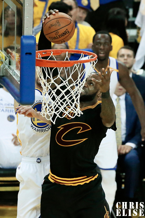 12 June 2017: Cleveland Cavaliers guard Kyrie Irving (2) grabs the rebound during the Golden State Warriors 129-120 victory over the Cleveland Cavaliers, in game 5 of the 2017 NBA Finals, at the Oracle Arena, Oakland, California, USA.