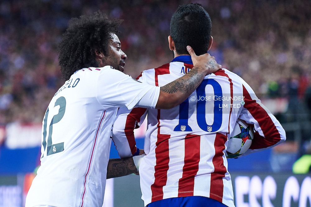Marcelo (Real Madrid F.C.) and Arda Turan in action during the Champions League, round of 4 match between Atletico de Madrid and Real Madrid at Estadio Vicente Calderon on April 14, 2015 in Madrid, Spain