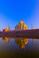 The Taj Mahal reflecting into the Yamuna River in the foreground, Agra, Uttar Pradesh, India
