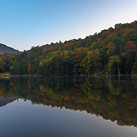 I traveled way up north to New Hampshire to Colebrook and Kidderville exploring Dixville Notch at the banks of Lake Gloriette. Loved the tranquility early in the morning and serene scenery, inspiring this New England photography picture. <br />