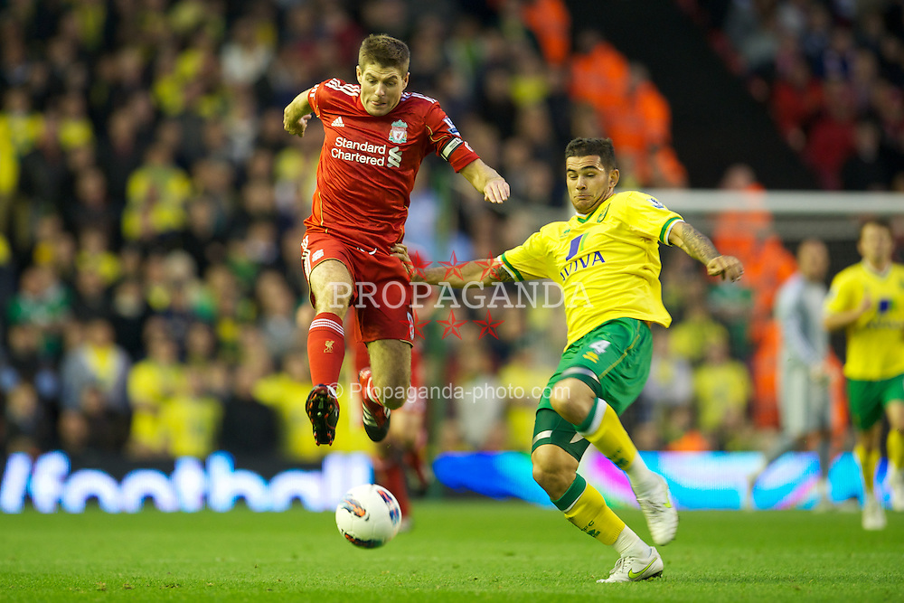 LIVERPOOL, ENGLAND - Saturday, October 22, 2011: Liverpool's captain Steven Gerrard MBE in action against Norwich City's Bradley Johnson during the Premiership match at Anfield. (Pic by David Rawcliffe/Propaganda)